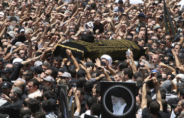Lebanese Shi'ite Muslim supporters of  Grand Ayatollah Sayyed Mohammed Hussein Fadlallah carry his coffin in Beirut's suburbs