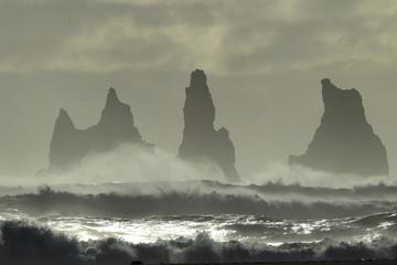 Reynisdrangar Sea Stacks, Iceland waves breaking on Renisfjara beach in front of the Reynisdrangar basalt sea stacks, southern Iceland