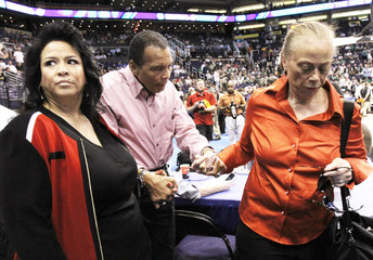 Former boxing great Muhammad Ali arrives with members of his family to attend the NCAA men's West Regional basketball tournament in Phoenix