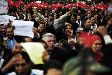 Protesters gesture during a demonstration in downtown Tunis