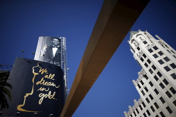 Oscars host Chris Rock is seen on a poster at the entrance to the Dolby Theatre red carpet on Hollywood Boulevard as preparations continue for the 88th Academy Awards in Hollywood