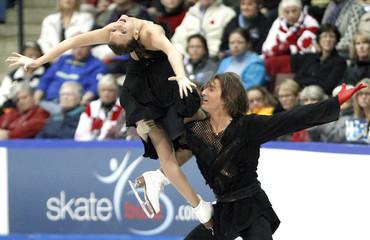 Ekaterina Pushkash and Jonathan Guerreiro of Russia perform at Skate Canada International in Mississauga