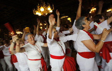 """Revellers dance during the traditional """"Baile de la Alpargata"""" (Alpargata dance) after the seventh running of the bulls at the San Fermin festival in Pamplona"""