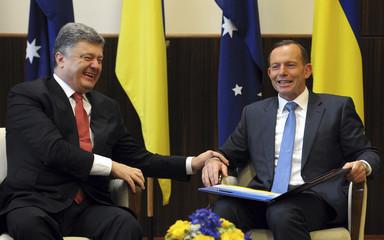 Australia's PM Abbott laughs with Ukraine's President Poroshenko during their meeting in Melbourne