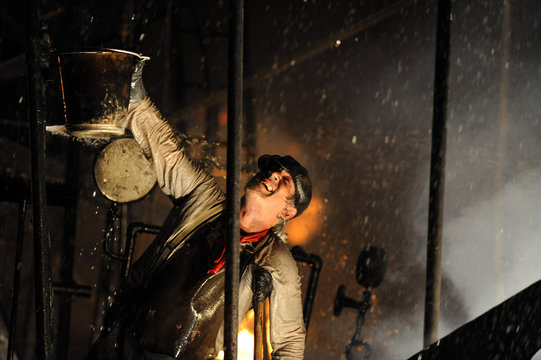 A performer takes part in the re-enactment of the sinking of the luxury liner RMS Titanic in Carlilse