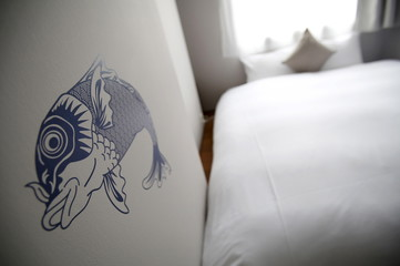 A carp painting is seen on the wall of a hotel room at Grids at the Akihabara shopping district in Tokyo