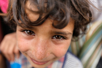 Boy is pictured at a camp for internally displaced people near Sanaa, Yemen