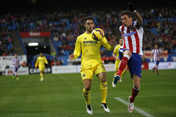 Atletico Madrid's Mario Mandzukic and Villareal's Victor Ruiz fight for the ball during their Spanish first division soccer match at Vicente Calderon stadium in Madrid