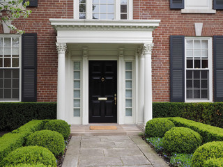 front door of house with elegant portico entrance