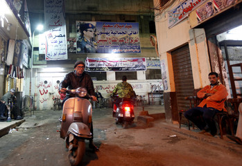 Posters of Army chief Abdel Fattah al-Sisi adorn the walls of an area of Cairo's Gamaliya district, where he spent his childhood