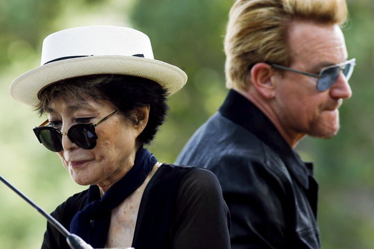 Artist Ono, widow of John Lennon, and Irish singer Bono attend the unveiling of a tapestry honoring Lennon at Ellis Island in New York