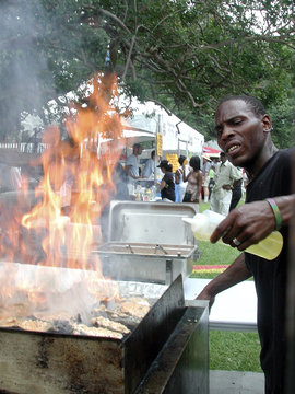 DeShawn Harris of Oceana Restaurant grills oysters at the Louisiana Seafood Festival in New Orleans, Louisiana