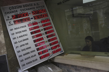 Foreign exchange rates are displayed on a screen outside of an exchange office in central Istanbul
