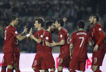 Portugal's Hugo Almeida celebrates his goal with team mates during their 2014 World Cup qualifying soccer match against Azerbaijan at the Tofig Bahramov Stadium in Baku