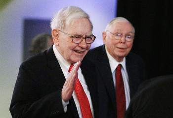 Berkshire Hathaway Chairman Buffett and Vice Chairman Munger arrive to begin the company's annual meeting in Omaha