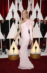 Actress Gwyneth Paltrow, wearing a custom Ralph & Russo pink one sleeve gown with a giant flower on the shoulder, arrives at the 87th Academy Awards in Hollywood, California