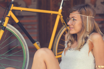Attractive cute girl with old bicycle.