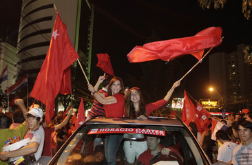 Supporters of Paraguayan presidential candidate Horacio Cartes of the Colorado Party celebrate in Asuncion