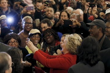 Democratic U.S. presidential candidate Hillary Clinton takes pictures with supporters at a campaign rally in the Bronx borough of New York City