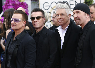 Bono, Larry Mullen, Jr., Adam Clayon, and The Edge from the band U2 arrive at the 71st annual Golden Globe Awards in Beverly Hills