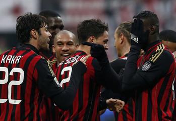 AC Milan's Kaka celebrates with Balotelli after scoring against Atalanta Bergamo during their Italian Serie A soccer match at the San Siro stadium in Milan