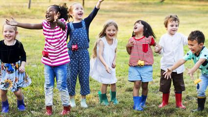 Group of kindergarten kids learning gardening outdoors field trips