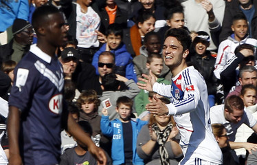 Olympique Lyon's Grenier celebrates after scoring against Girondins Bordeaux during their French Ligue 1 soccer match in Bordeaux