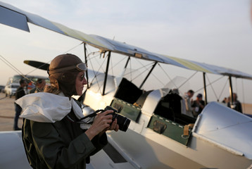 Alexandra Maingard takes a picture of the biplane before flying over Egypt's iconic pyramids of Giza, on the second leg of their month-long journey through Africa in Cairo