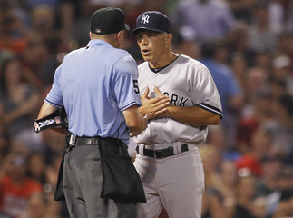 New York Yankees Manager Joe Girardi argues with home plate umpire Mike Everitt after he ejected New York Yankees Brett Gardner from the game during the fifth inning of American League MLB baseball action at Fenway Park in Boston