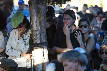 Relatives and friends of Israeli soldier Daniel Pomerantz who was killed during fighting in Gaza on Sunday, mourn during his funeral in Kfar Azar, near Tel Aviv