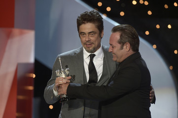 Puerto Rican actor Del Toro receives his Donostia Award for career achievement from actor Perugorria at the San Sebastian Film Festival