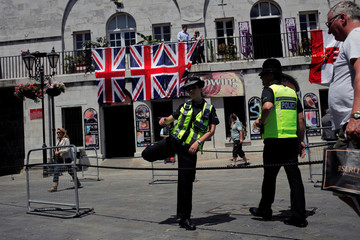 "Gibraltarian police officers patrol Casemates square before the cancellation of the ""Stronger In"" campaign event before the death of lawmaker Jo Cox, in the British overseas territory Gibraltar, historically claimed by Spain"