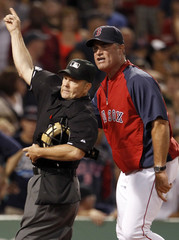 Red Sox manager John Farrell is ejected from the game by home plate umpire Jerry Meals during their MLB American League Baseball game against the Rays in Boston