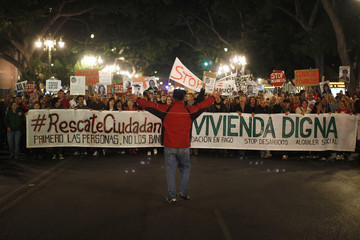 """People march during a demonstration demanding """"The right to decent housing, stop evictions, the retroactive payment in kind and social rents"""" in Malaga"""