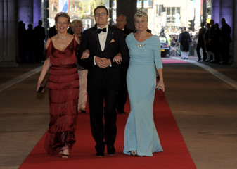 Dutch Prince Constantijn, his wife Princess Laurentien and Princess Mabel arrive at a gala dinner organised on the eve of the abdication of Queen Beatrix of the Netherlands in Amsterdam