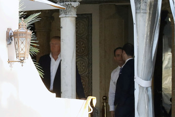 U.S. President-elect Donald Trump and incoming White House Chief of Staff Reince Priebus stand on a balcony at the Mar-a-Lago estate in Palm Beach, Florida