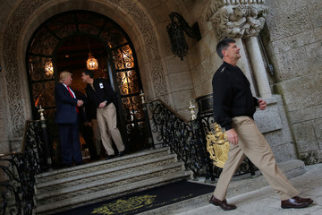 U.S. President-elect Donald Trump shakes hands with Pentagon officials after a meeting at Mar-a-Lago estate in Palm Beach, Florida, U.S.