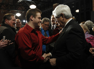 U.S. Republican presidential candidate and former Speaker of the House Newt Gingrich shakes a supporter's hand during a campaign stop in Columbus, Ohio