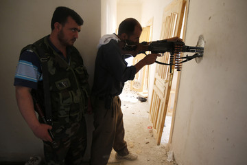 A Free Syrian Army sniper takes his position in the Salah El Dine neighbourhood of Syria's northwest city of Aleppo