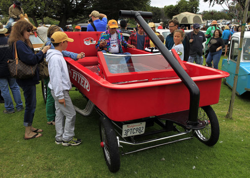 A car built in the likeness of a Radio Flyer Wagon is displayed during the Concours d'Lemons in Seaside, California