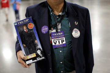 A supporter of Republican U.S. presidential nominee Donald Trump holds a Trump doll at a campaign rally in Charlotte
