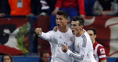 Real Madrid's Ronaldo is congratulated by teammate Bale after scoring a goal against Atletico Madrid during their Spanish first division soccer match in Madrid