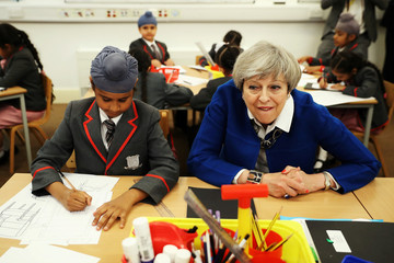 Britain's Prime Minister Theresa May meets the Nishkam Trust leadership team and pupils of Nishkam Primary School in Birmingham