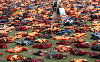 A display of lifejackets worn by refugees during their crossing from Turkey to the Greek island of Chois, are seen Parliament Square in central Londo