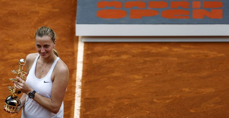 Czech Republic's Kvitova holds the trophy after winning the final against Russia's Kuznetsova at the Madrid Open tennis tournament in Madrid