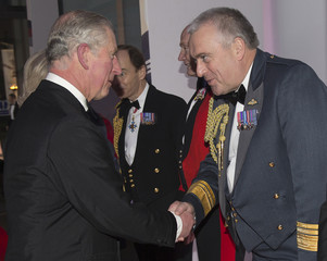 Britain's Prince Charles shakes hands with Air Marshal North at The Sun Military Awards in Greenwich
