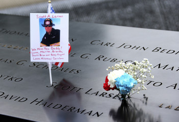 Messages and flowers left on inscribed names at the north pool are seen during memorial observances held at the site of the World Trade Center in New York