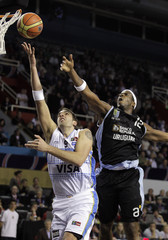 Argentina's Gutierrez scores over Uruguay's Newsome during their first round match of the FIBA Americas Championship in Mar del Plata