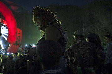 A woman looks at her cell phone during the Global Citizen Festival concert in Central Park in New York