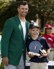 Masters champion Adam Scott poses for a picture with Lydia Swan of North East, Pennsylvania after she won the Girls 10-11 year-old overall at Augusta National.